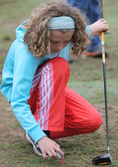 """<div class=""""source"""">Photo by John Overby</div><div class=""""image-desc"""">Paige Hoyer sets up her next shot on the tee. </div><div class=""""buy-pic""""><a href=""""/photo_select/16593"""">Buy this photo</a></div>"""
