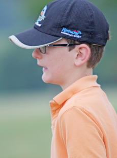 """<div class=""""source"""">Photo by John Overby</div><div class=""""image-desc"""">Trey Hoyer watches one of his tee shots during the last day of the camp.</div><div class=""""buy-pic""""><a href=""""/photo_select/16591"""">Buy this photo</a></div>"""