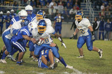 """<div class=""""source"""">Jimmie Earls</div><div class=""""image-desc"""">Freshman running back Tyler Loving, right, cuts to the outside during the Commanders' blue/gold scrimmage game last Friday night.</div><div class=""""buy-pic""""><a href=""""/photo_select/3863"""">Buy this photo</a></div>"""