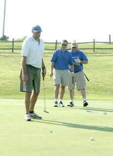 """<div class=""""source"""">Jimmie Earls</div><div class=""""image-desc"""">WC athletic director Glenn Goatley watches his putt find the hole as Commander head coach Mark Perry, center, and Hal B. Goode, right, look on.</div><div class=""""buy-pic""""><a href=""""http://web2.lcni5.com/cgi-bin/c2newbuyphoto.cgi?pub=023&orig=web_golf_goatleyperrygoode.jpg"""" target=""""_new"""">Buy this photo</a></div>"""