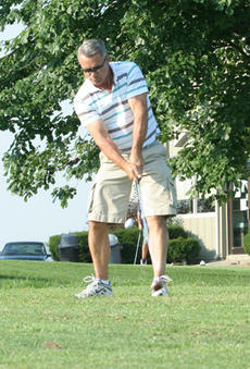 """<div class=""""source"""">Jimmie Earls</div><div class=""""image-desc"""">Perry Wheatley tees off on the first hole at Lincoln Homestead Golf Course during the Fourth Annual Commander Golf Classic last Saturday.</div><div class=""""buy-pic""""><a href=""""http://web2.lcni5.com/cgi-bin/c2newbuyphoto.cgi?pub=023&orig=web_golf_perrywheatley.jpg"""" target=""""_new"""">Buy this photo</a></div>"""