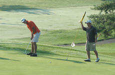 """<div class=""""source"""">Jimmie Earls</div><div class=""""image-desc"""">Matthew Smith, left, holes a putt on the 15th hole while Mikie Yates holds the pin. Their group, which also included Larry Smith and Joe B. Yates, won the tournament, shooting a 15-under 56 to win by five strokes on the par 71 course.</div><div class=""""buy-pic""""><a href=""""http://web2.lcni5.com/cgi-bin/c2newbuyphoto.cgi?pub=023&orig=web_golf_smithyates.jpg"""" target=""""_new"""">Buy this photo</a></div>"""