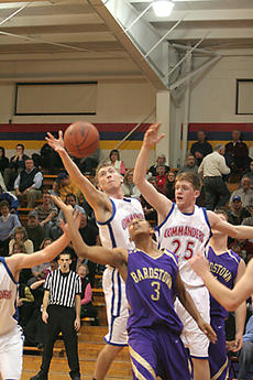 """<div class=""""source"""">Jimmie Earls</div><div class=""""image-desc"""">Washington County senior Harrison Simms, left and junior Will Purdom, right, battle for the ball against Bardstown freshman Marcus Cosby last week in district action. The Commanders came up short in the 48-38 loss.</div><div class=""""buy-pic""""><a href=""""/photo_select/2513"""">Buy this photo</a></div>"""
