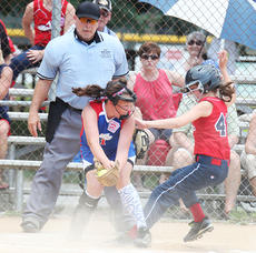 """<div class=""""source"""">Photo by Jeff Moreland</div><div class=""""image-desc"""">Catcher Ava Abell makes a play at the plate in 9-10-year-old all-star action.</div><div class=""""buy-pic""""><a href=""""/photo_select/16670"""">Buy this photo</a></div>"""