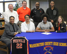 "<div class=""source"">Photo by John Overby</div><div class=""image-desc"">Washington County senior Jennifer Keene (front row, second from right) signed on to play basketball with the University of Pikeville Bears last week. Back row from left to right: WCHS Principal Paul Terrell; University of Pikeville womens' basketball assistant coach Curtis Metten; former WCHS girls' basketball head coach Bernard Smalley and Keene's brother, Wesley. Front row from left to right:  Keene's pastor Y. Michelle Washington; Keene's mother, Julia; Keene  and University of Pikeville womens' basketball head coach Joanna Bernabei-McNamee. </div><div class=""buy-pic""><a href=""/photo_select/16208"">Buy this photo</a></div>"