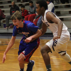 """<div class=""""source"""">Photo by John Overby</div><div class=""""image-desc"""">Senior Thomas Pettus drives on an Eagle defender.</div><div class=""""buy-pic""""><a href=""""/photo_select/15588"""">Buy this photo</a></div>"""