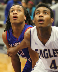 """<div class=""""source"""">Photo by John Overby</div><div class=""""image-desc"""">Senior Ty'Lyn Byas (10) anticipates where a free throw will bounce off the rim.</div><div class=""""buy-pic""""><a href=""""/photo_select/15590"""">Buy this photo</a></div>"""
