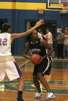 """<div class=""""source"""">Jimmie Earls</div><div class=""""image-desc"""">Commanderette freshman center Kenya Turner, left, eyes the basket as Washington County held a six-point lead in the fourth quarter against Bardstown Friday night. Turner led WC scoring with 17 points in the 54-49 win.</div><div class=""""buy-pic""""><a href=""""/photo_select/983"""">Buy this photo</a></div>"""