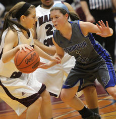 """<div class=""""source"""">Photo by John Overby</div><div class=""""image-desc"""">Sophomore Lexi Thompson goes toe-to-toe with a Marion County guard. </div><div class=""""buy-pic""""><a href=""""/photo_select/15818"""">Buy this photo</a></div>"""