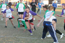 """<div class=""""source"""">Jimmie Earls</div><div class=""""image-desc"""">Washington County senior Kelly Hill, center, takes the ball during the annual powder puff football game at WCHS last Thursday. The seniors tied the game at 12-12 at the end of regulation and won it in a tiebreaker.</div><div class=""""buy-pic""""><a href=""""http://web2.lcni5.com/cgi-bin/c2newbuyphoto.cgi?pub=023&orig=web_pp_hill.jpg"""" target=""""_new"""">Buy this photo</a></div>"""