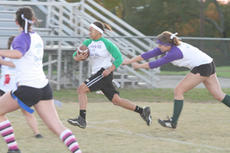 """<div class=""""source"""">Jimmie Earls</div><div class=""""image-desc"""">Sophomore running back Shay Yocum flies past the outstretched arms of a senior defender during the annual powder puff football game last week at Washington County High School. </div><div class=""""buy-pic""""><a href=""""http://web2.lcni5.com/cgi-bin/c2newbuyphoto.cgi?pub=023&orig=web_pp_yocum.jpg"""" target=""""_new"""">Buy this photo</a></div>"""