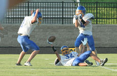 """<div class=""""source"""">Jimmie Earls</div><div class=""""image-desc"""">Commander sophomore defensive back Marcus Reardon, center, comes up with a fumble recovery against North Oldham as Washington County scrimmaged against the Mustangs last Friday night in Goshen. Celebrating with Reardon are teammates junior defensive back </div><div class=""""buy-pic""""><a href=""""/photo_select/4127"""">Buy this photo</a></div>"""