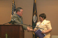 """<div class=""""source"""">Jimmie Earls</div><div class=""""image-desc"""">Washington County Judge-Executive John Settles, left, greets Dr. Thelma White, president and CEO of Elizabethtown Community and Technical College, during a dedication ceremony for the college's new Springfield campus Thursday.</div><div class=""""buy-pic""""><a href=""""/photo_select/2279"""">Buy this photo</a></div>"""