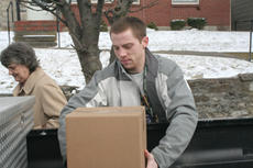 """<div class=""""source"""">Jimmie Earls</div><div class=""""image-desc"""">SCC junior guard Kris Caufield helps a recipient with her box of commodities last Thursday.</div><div class=""""buy-pic""""><a href=""""/photo_select/6178"""">Buy this photo</a></div>"""