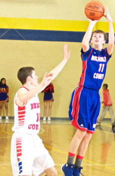 """<div class=""""source"""">PETER W. ZUBATY/Landmark News Service</div><div class=""""image-desc"""">Washington County's Thomas Pettus puts up a jumper against Nelson County in the Commanders' 75-58 loss Monday in the 19th District tournament.</div><div class=""""buy-pic""""><a href=""""http://web2.lcni5.com/cgi-bin/c2newbuyphoto.cgi?pub=023&orig=web_thomas_pettus_district_tourney.jpg"""" target=""""_new"""">Buy this photo</a></div>"""