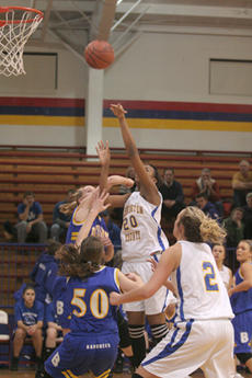 "<div class=""source"">Jimmie Earls</div><div class=""image-desc"">Washington County junior center Ange Umulisa puts two points on the board as the Commanderettes beat Bethlehem in overtime last Friday.</div><div class=""buy-pic""><a href=""/photo_select/1938"">Buy this photo</a></div>"