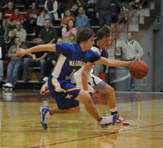 """<div class=""""source"""">Richard RoBards</div><div class=""""image-desc"""">Commander sophomore Trae Abell surges past the Cardinal defense toward the basket as Washington County opened the 2009-10 season with a 62-23 loss to Taylor County last Tuesday.</div><div class=""""buy-pic""""><a href=""""/photo_select/4222"""">Buy this photo</a></div>"""