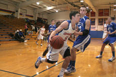 """<div class=""""source"""">Jimmie Earls</div><div class=""""image-desc"""">Commander senior point guard Alex Simms (5) drives the lane against LaRue County senior forward Christian Mullins as the Commanders lost 48-44 to the Hawks last Wednesday at home.</div><div class=""""buy-pic""""><a href=""""/photo_select/4533"""">Buy this photo</a></div>"""