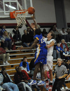 """<div class=""""source"""">Richard RoBards</div><div class=""""image-desc"""">Washington County junior Qwan Turner, left, fights to put the ball in the hoop in season-opening action vs. Taylor County last week.</div><div class=""""buy-pic""""><a href=""""/photo_select/4221"""">Buy this photo</a></div>"""