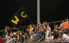"<div class=""source"">Jimmie Earls</div><div class=""image-desc"">WCHS students cheer for their Commanders last Friday night in Springfield.</div><div class=""buy-pic""><a href=""/photo_select/6532"">Buy this photo</a></div>"