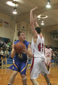 "<div class=""source"">Jimmie Earls</div><div class=""image-desc"">Commander junior center Will Purdom (25) goes up for two points against Bardstown in district boys' basketball action last week. Washington County kept pace with the Tigers, but lost in the final seconds, 55-53.</div><div class=""buy-pic""><a href=""http://web2.lcni5.com/cgi-bin/c2newbuyphoto.cgi?pub=023&orig=web_willpurdom.jpg"" target=""_new"">Buy this photo</a></div>"