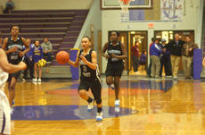 "<div class=""source"">Jimmie Earls</div><div class=""image-desc"">Washington County sophomore Shay Yocum hustles toward the basket while teammate Kenya Turner looks back to watch the play develop. The Commanderettes won 42-40 in overtime to avoid finishing last in district standings.</div><div class=""buy-pic""><a href=""/photo_select/1939"">Buy this photo</a></div>"