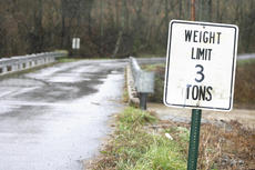 "<div class=""source"">Jesse Osbourne</div><div class=""image-desc"">The bridge on Tick Creek Road has reopened, but will still be subject to a three-ton weight limit.</div><div class=""buy-pic""><a href=""http://web2.lcni5.com/cgi-bin/c2newbuyphoto.cgi?pub=023&orig=weight%2Blimit_0.jpg"" target=""_new"">Buy this photo</a></div>"