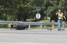 """<div class=""""source"""">Photo by Brandon Mattingly</div><div class=""""image-desc"""">Springfield Fire Chief Jim Logsdon directs traffic following a wreck in Fredericktown last Wednesday that sent one to the hospital.</div><div class=""""buy-pic""""><a href=""""/photo_select/17067"""">Buy this photo</a></div>"""