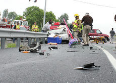 "<div class=""source"">Jeff Moreland</div><div class=""image-desc"">Emergency personnel were on the scene of an accident at the intersection of KY 555 and the new US 150 Bypass Wednesday morning. The accident involved a car and a tractor-trailer.</div><div class=""buy-pic""></div>"