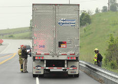 "<div class=""source"">Jeff Moreland</div><div class=""image-desc"">Washington County sheriff's deputy Jackie Robinson, left, and other emergency personnel were on the scene of an accident at the intersection of KY 555 and the new US 150 Bypass Wednesday morning. The accident involved a car and a tractor-trailer.</div><div class=""buy-pic""></div>"
