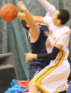 """<div class=""""source"""">Photo by John Overby</div><div class=""""image-desc"""">WC senior Marcus Wright makes an emphatic block against Thomas Nelson but is called for a foul.</div><div class=""""buy-pic""""><a href=""""/photo_select/15513"""">Buy this photo</a></div>"""