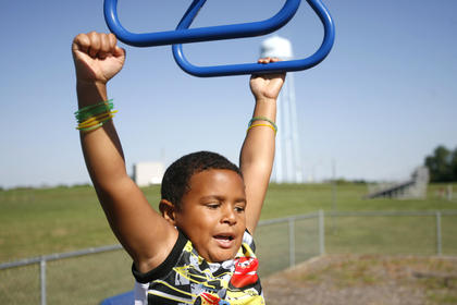 Lamont Estes braved the monkey bars on the first day of school.