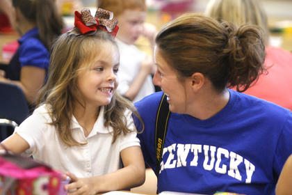 Emma Reinle, left, and her mom Robyn, right, shared a moment before class began. 