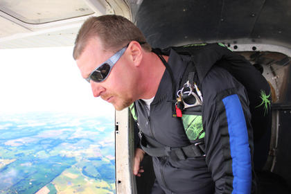 Woods prepared to jump from the plane during his all-day skydive marathon.