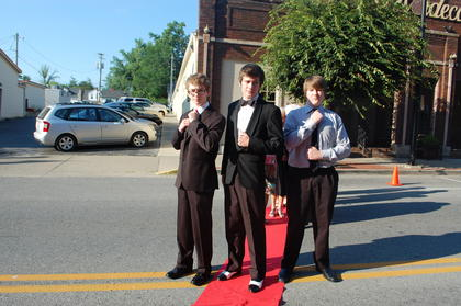 "Handsome and sophisticated men about town, Youth Actor Best Actor Nominees Aaron Robinson, ""Les Mis"" and Scott Humphress, ""Taming of the Shrew""strike a pose on the red carpet with their friend and fellow actor, the debonair, Thomas Adler on their way to the Central Kentucky Community Theatre Jeannie Awards Gala, Monday, June 13."