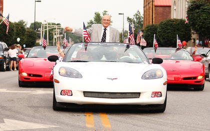 Springfield Mayor Dr. John W. Cecconi waved to the crowd during Friday's parade. Cecconi, a U.S. Army veteran, was one of many veterans in Friday's parade. Veterans were given rides in the parade by members of The Bluegrass Corvette Club of Lexington.