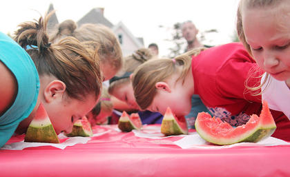 Local youngsters took part in the watermelon-eating contests held in the office lawn of local dentist, Dr. Ben Smith.