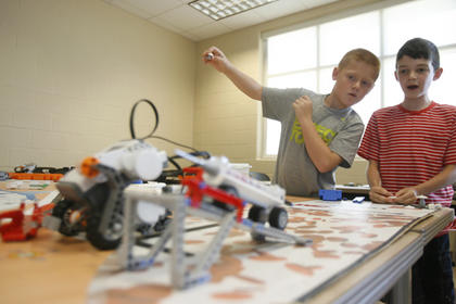 Blake Arnold, left, and Noah George, right, watched to see if their robot would navigate the obstacle course successfully on Friday at the Elizabethtown Community and Technical College campus in Springfield. They were participating in a week-long robotics camp.