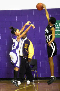 Senior Kayla Edelen blocked Bardstown senior Cierra Allen.