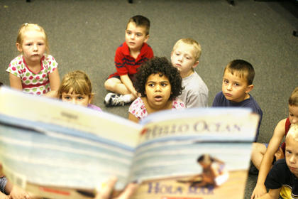 Students listened intently to Hello Ocean by Pam Munoz Ryan during summer camp at Washington County Elementary School last week.
