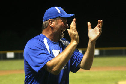 Coach Dale Bartley celebrated the state tournament bid after the final out of the Adair County game.