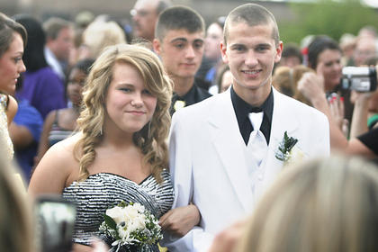 Haley Grigsby and Cody Fenwick made their way through the crowd before prom started.