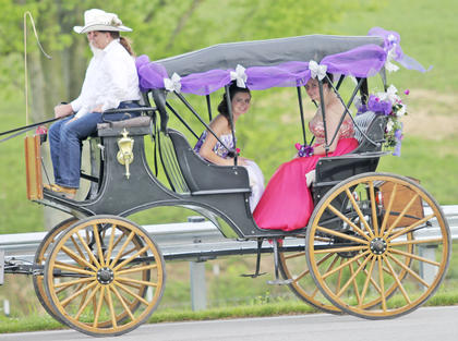 Brianna Jones, left, and Courtney Jones go for a horse and buggy ride.