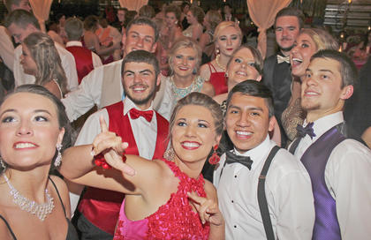 Students take a quick break from dancing to pose for a photo. To see more photos from this year's prom.