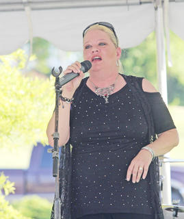 "Sondra ""Spanky"" Presley, lead singer of blues band Velveeta Jones, belts out a tune."