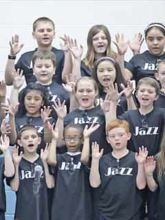 Many crowd members had their cell phones out taking videos and pictures during the event. WCES fourth-graders show off their jazz hands.