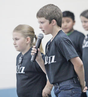 Fourth-graders not only sang famous jazz songs and songs dedicated to the legends of jazz music, but they also told the crowd about the history of the genre, as Hunter Coulter is shown doing above.