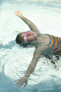 Emily Roberts worked on her floating skills during her swimming lesson. 