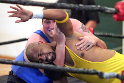 Above, Ravishing Ronnie Roberts, front, found himself in a headlock from Major League Chris Majors, back, during Mackville Mayhem on Friday at the Mackville Community Center. Prime Time Wrestling will return to Mackville in July. 