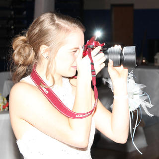 Madison Whitaker snaps a photo of some friends at the Washington County High School prom.g